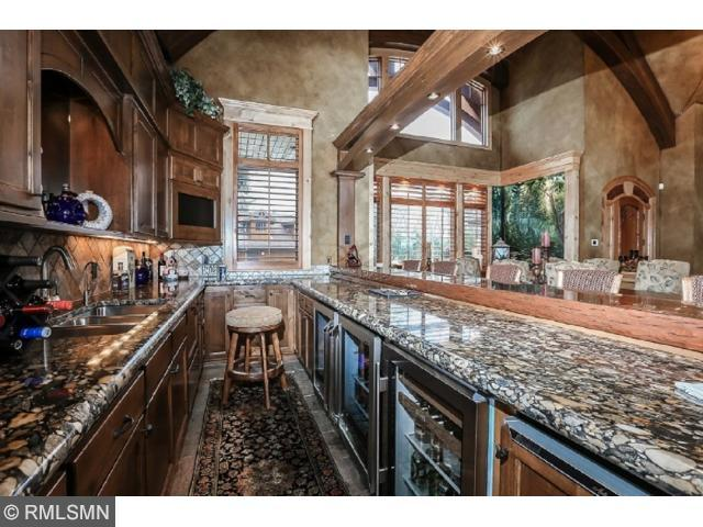 Custom winding wood staircase with natural lighting, towering vaults and view of great room!
