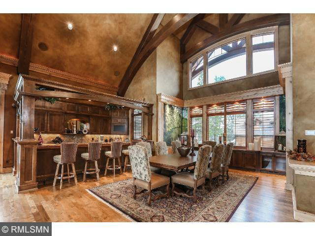 Two story stone gas fireplace in great room with television insert that also can be used to access the home security system. Wood floors and vaulted ceilings. Access to lake on north side.