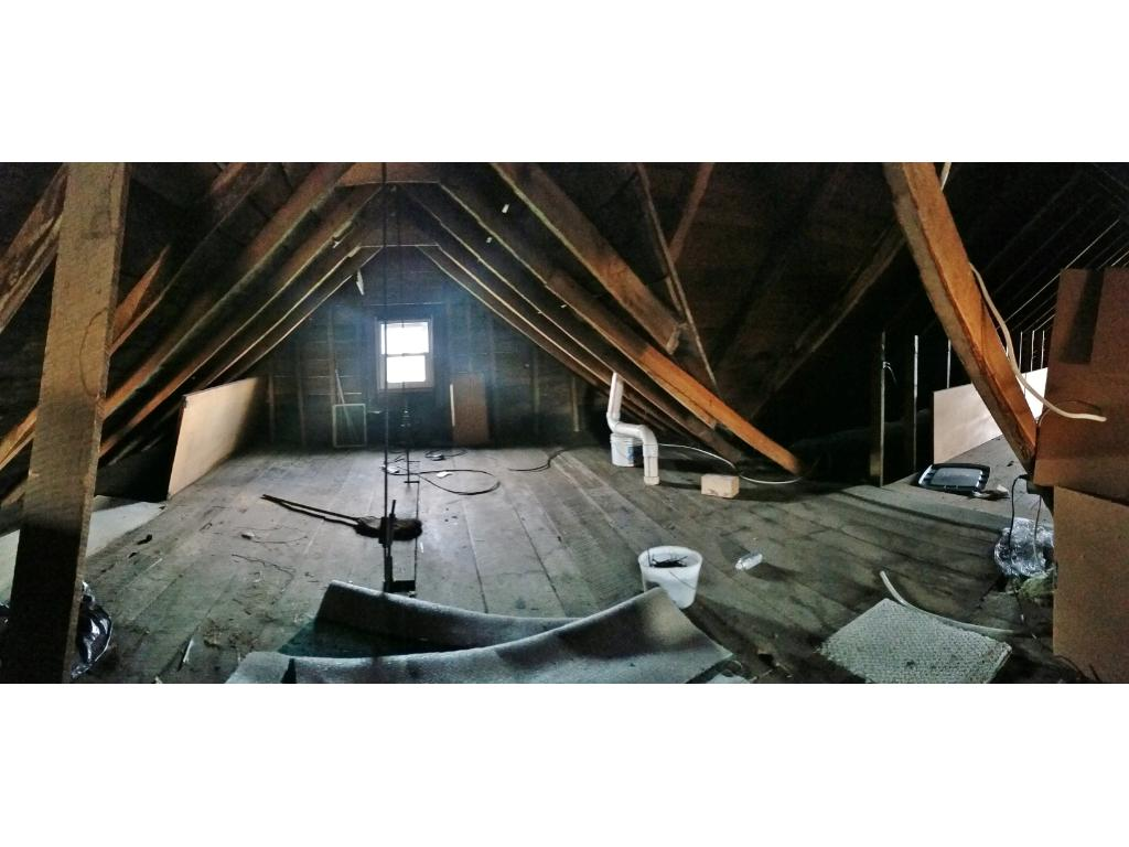 Attic that would be great for storage or an additional room after some remodeling!