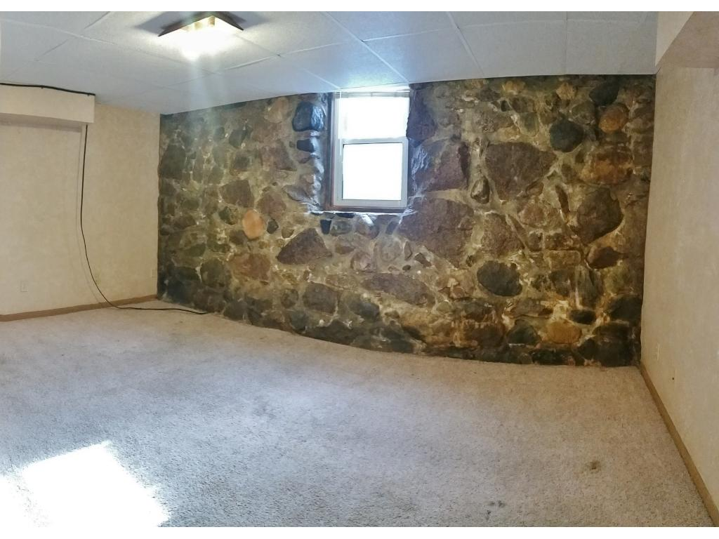 Mother in law suite in the lower level with a beautiful stone wall!