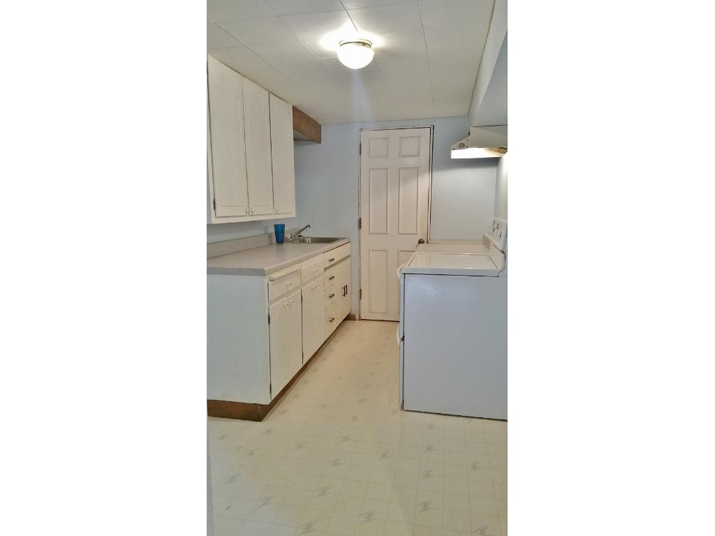 Laundry room with lots of storage and counter space in the Mother in law suite!