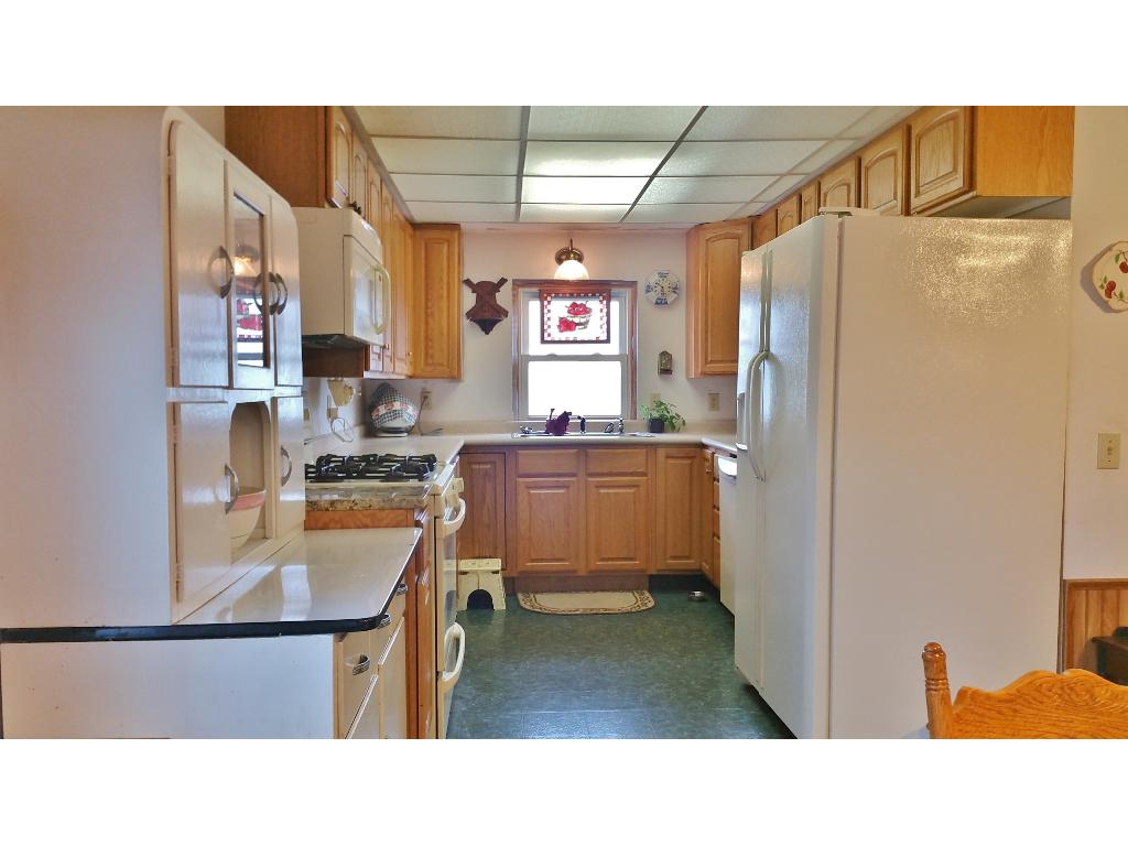 Great walk thru kitchen with lots of storage space and counter space!