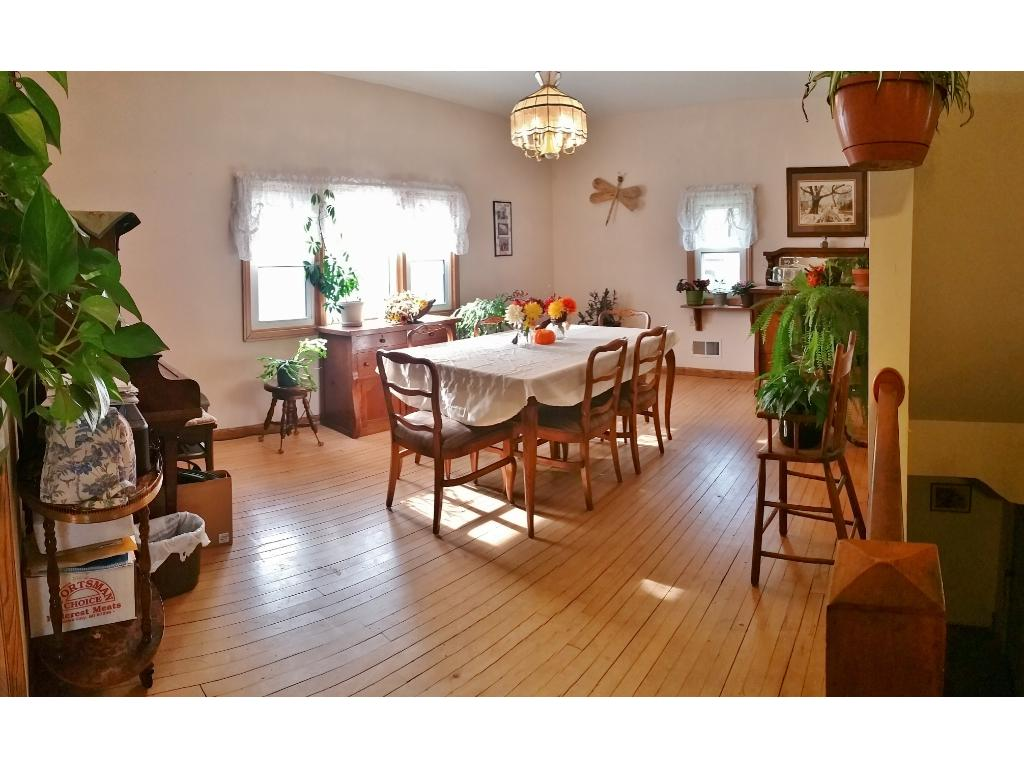 Great hardwood floors and lots of natural light in this spacious formal dining room that will be wonderful for all your entertaining needs!