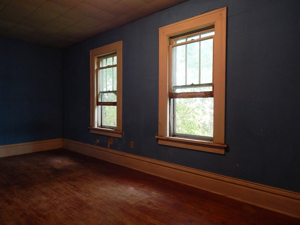 Second floor bedroom, possibly used as a nursery, plenty of storage and natural light.
