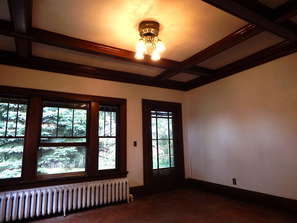 The detail put into this ceiling gives this room so much character.