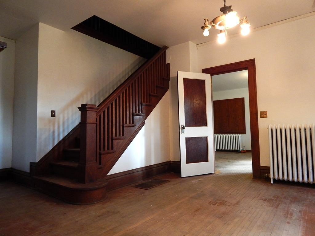 Close the kitchen up to clean later when entertaining. Notice the statement the staircase makes? WOW.