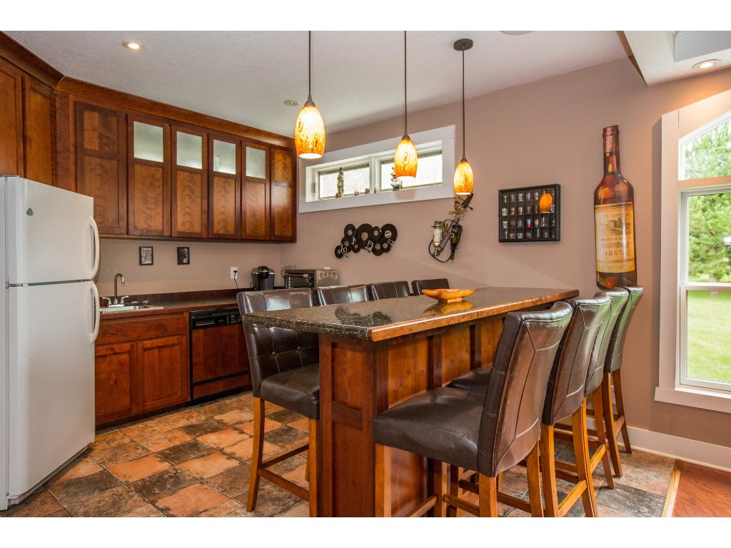 Lower level kitchenette is great for entertaining.