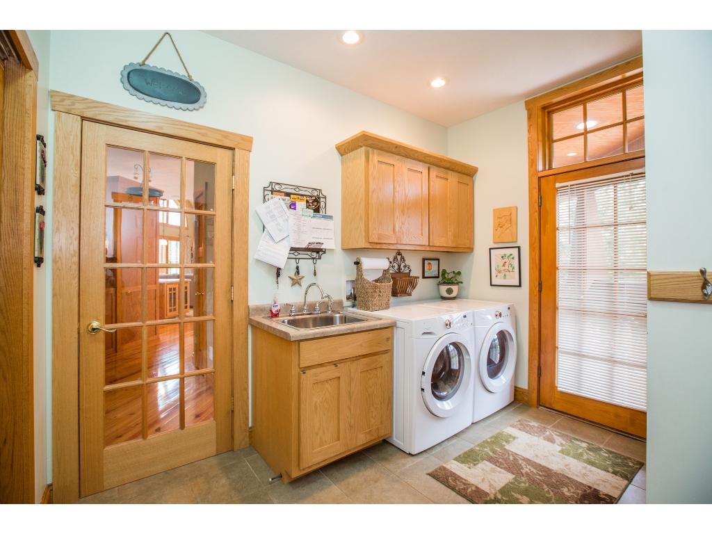 Laundry right off the garage and kitchen - perfect location. Door walks out to front porch.