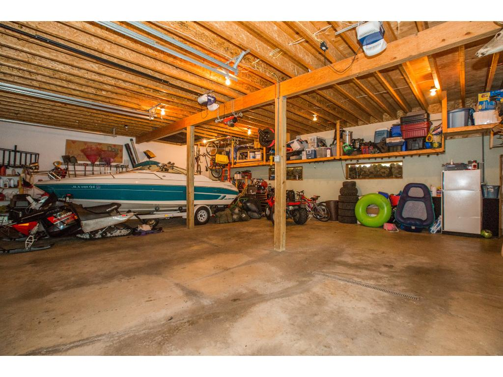 Large garage with extra room in the front for storage.
