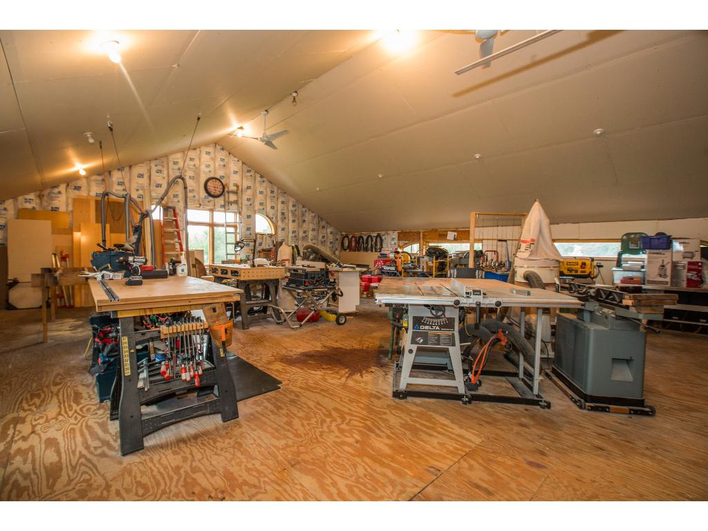Workshop is heated and located above the garage.  Could be additional living space.