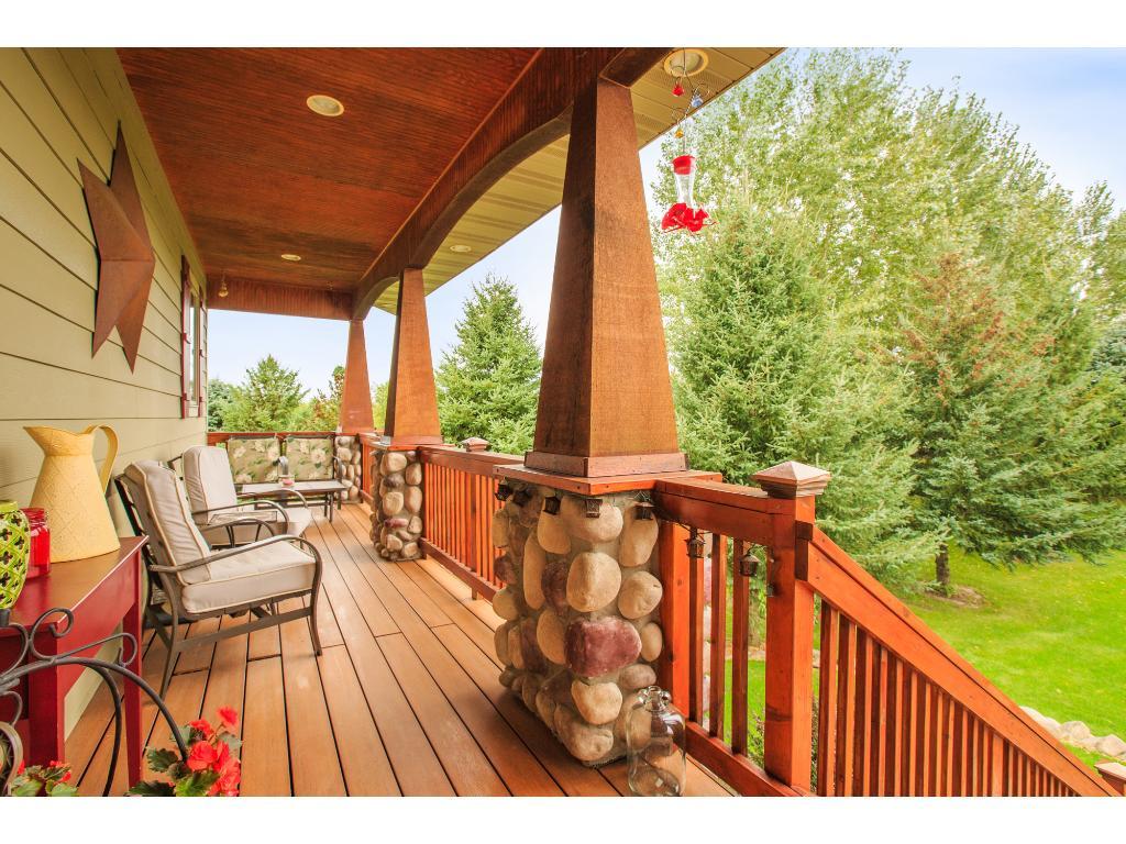 Quaint porch overlooks front yard.