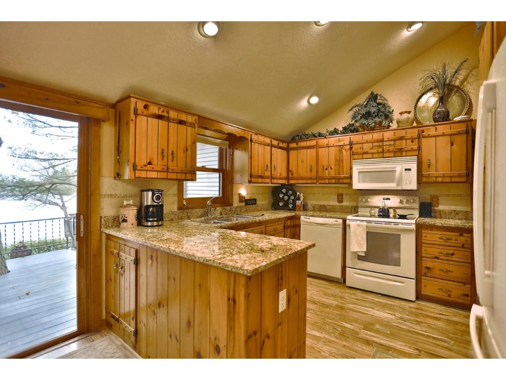 Custom kitchen with granite countertops and newer appliances.