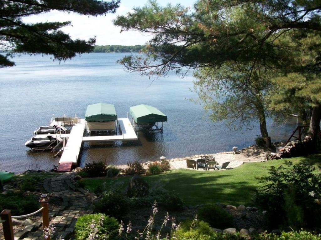 View from the lakeside deck looking out to the lake, the dock and boatlift are included with the sale of the property.
