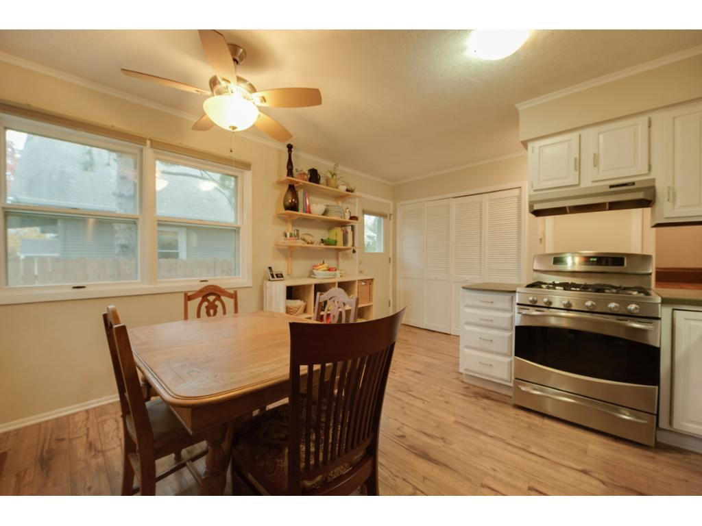 Also offered are numerous large bright windows, built-in open shelving for additional storage or display + large pantry closet! Nearby you can access the unfinished lower level w/laundry & tons of room for storage!
