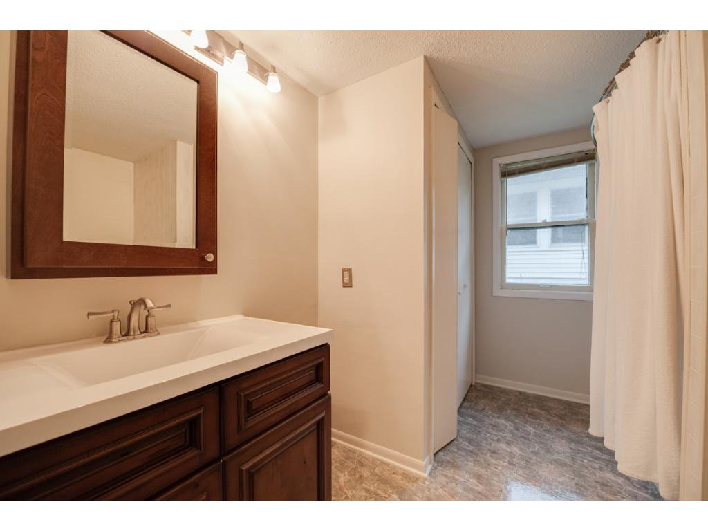 A nicely updated full bath on the main level includes new vanity w/ matching mirrored medicine cabinet above, tub/shower combo, large window & linen closet.