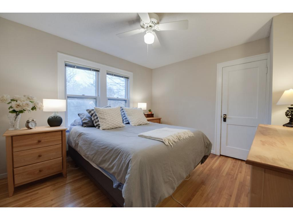 Upper level features original Maple hardwood floors thru-out! Master bedroom offers large sun-filled windows, ceiling fan & walk-in closet.