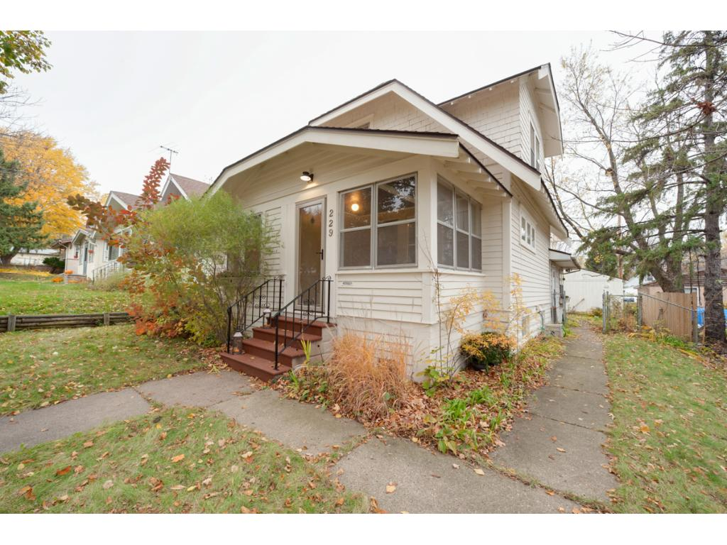 View of the front of this charming home! Close to downtown St. Paul & only 1.5 miles to Harriet Island & the Mississippi River. Walk to the grocer, baker & restaurants! Make sure you check this one out!