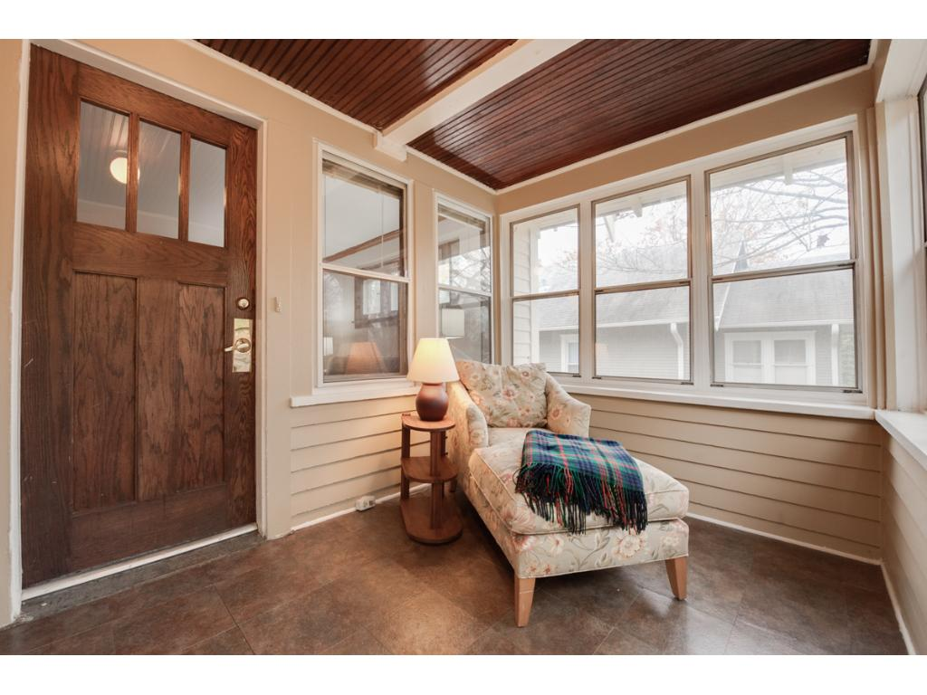 A charming 3-season porch is an excellent 1st impression upon entering! Features walls of windows & an attractive eye-catching ceiling. Home also offers new exterior doors in 2016 & exterior painted in 2013.