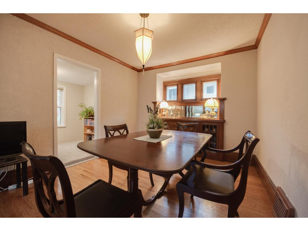 The dining room highlights the character of the home w/ beautiful original built-in buffet! Room provides plenty of space for a large table & is a great gathering area for entertaining or dining!