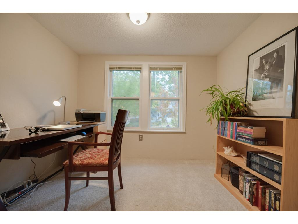Main level office includes new carpet & large sun-filled front facing window. Home includes in-home security system for added peace of mind.