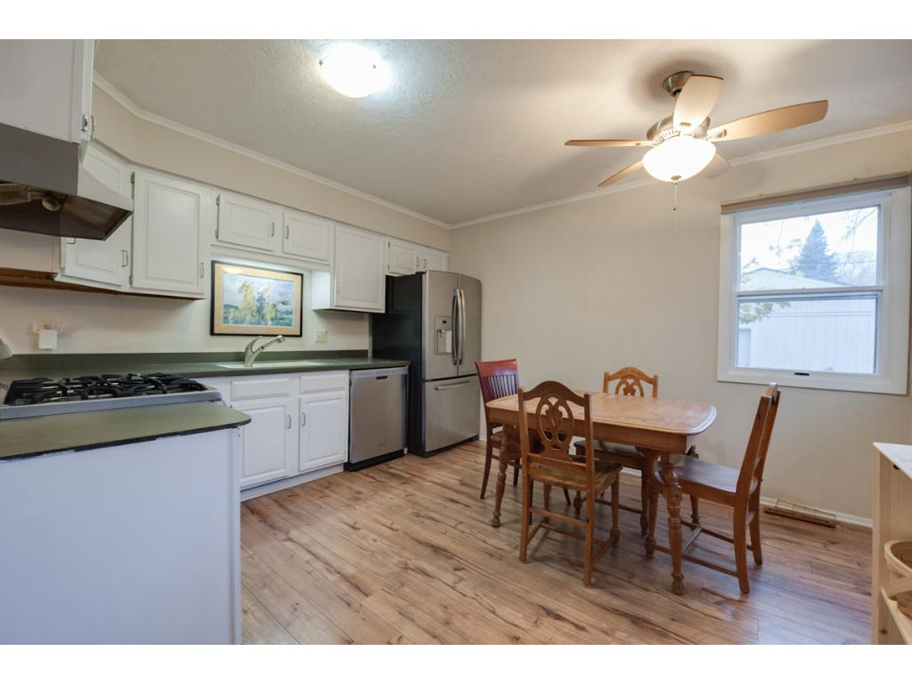 This eat-in kitchen is so spacious! Includes updated flooring, newer stainless steel appliances including gas range & a handy ice/water dispenser on the fridge! Plenty of room for a table & chairs w/ ceiling fan above & views of the backyard!