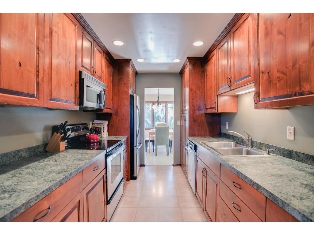 This Fabulous Kitchen Features Custom Made Cabinets, With Tons Of Counter  And Cabinet Space.