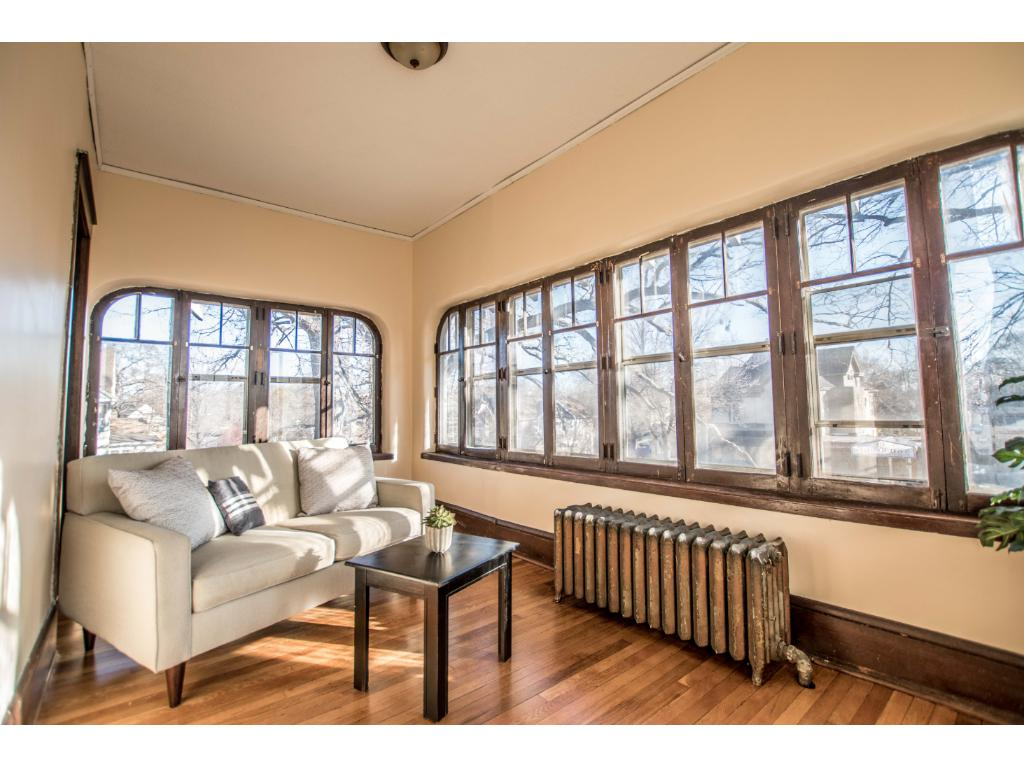 Sun drenched front porch,den,office or 4th bedroom.