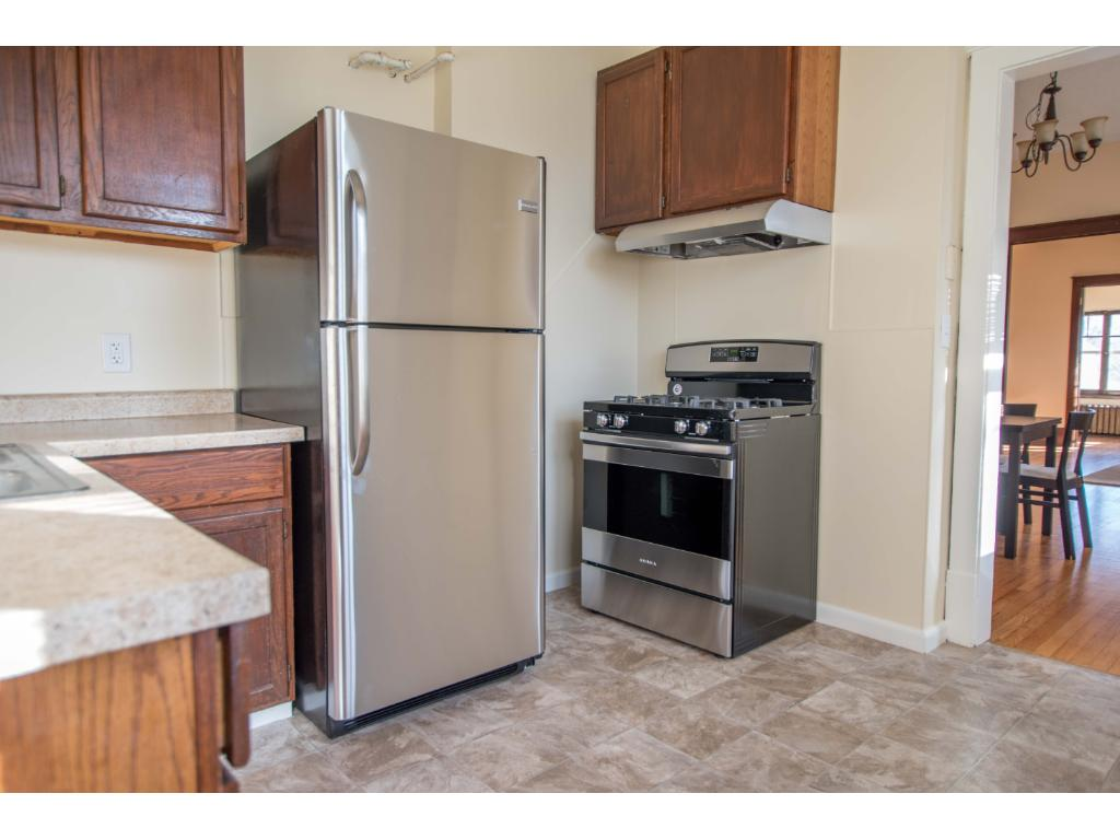 Upper level Kitchen with stainless steel appliances.