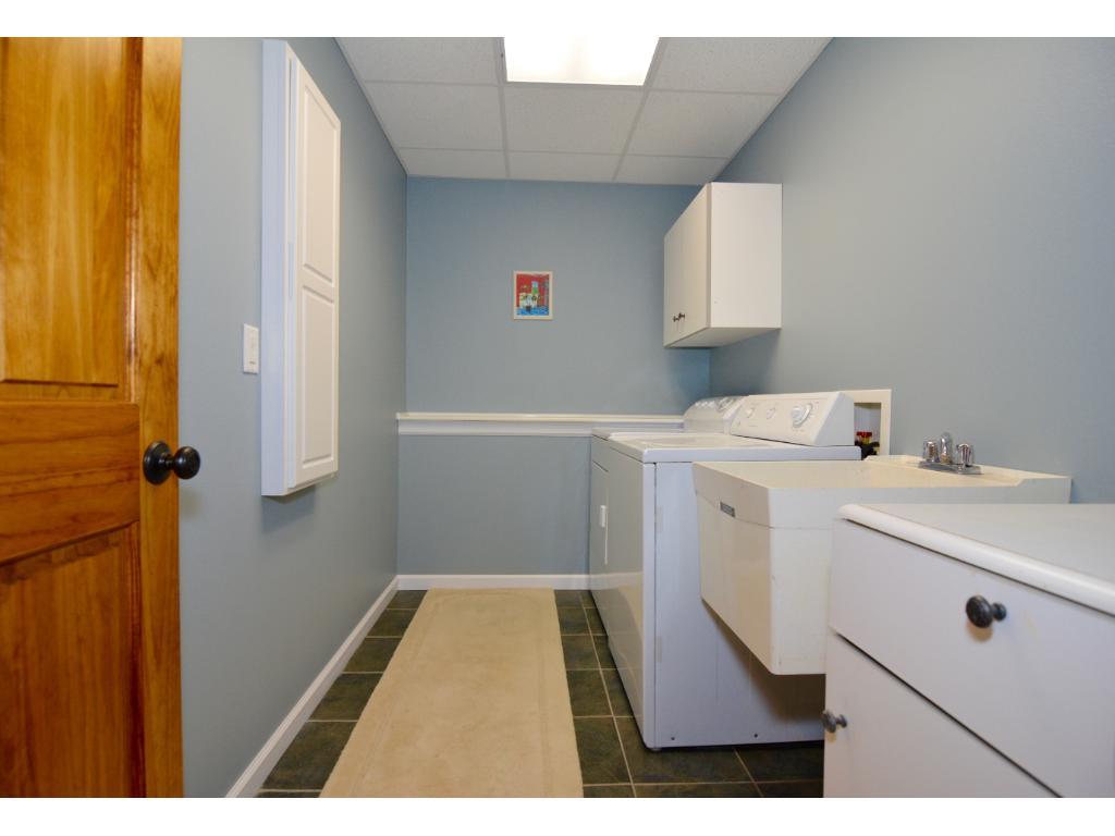 Huge basement level laundry room area.