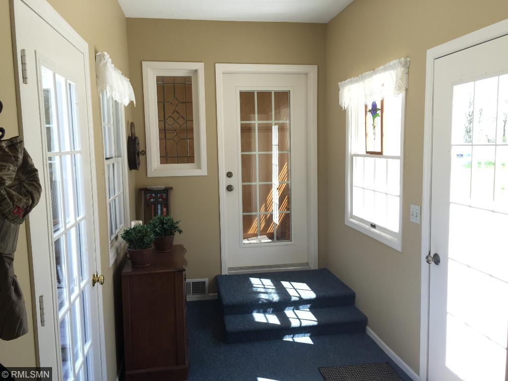 Sun Porch has easy access to shop and garage.