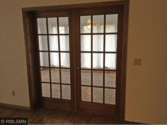 french doors open into sunroom that is 11x15