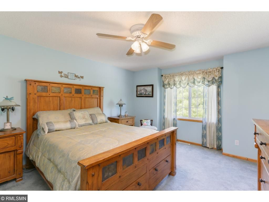 The master bedroom is spacious and bright, with an inset window!