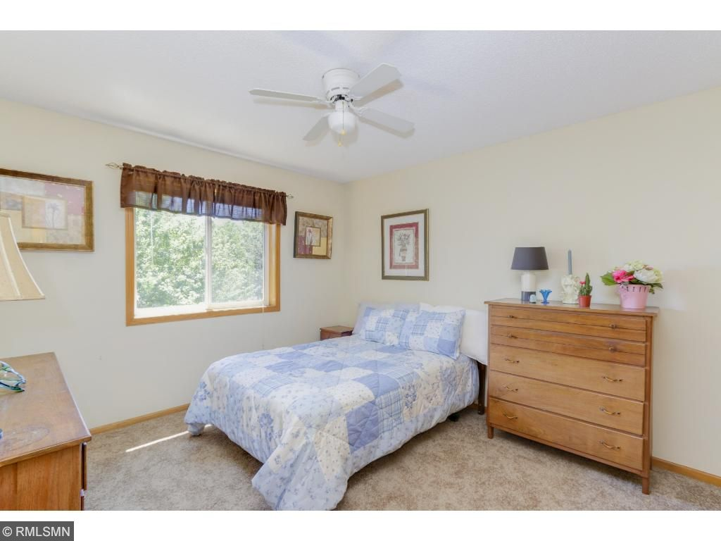 The second bedroom is light and bright - all it needs are your personal touches!