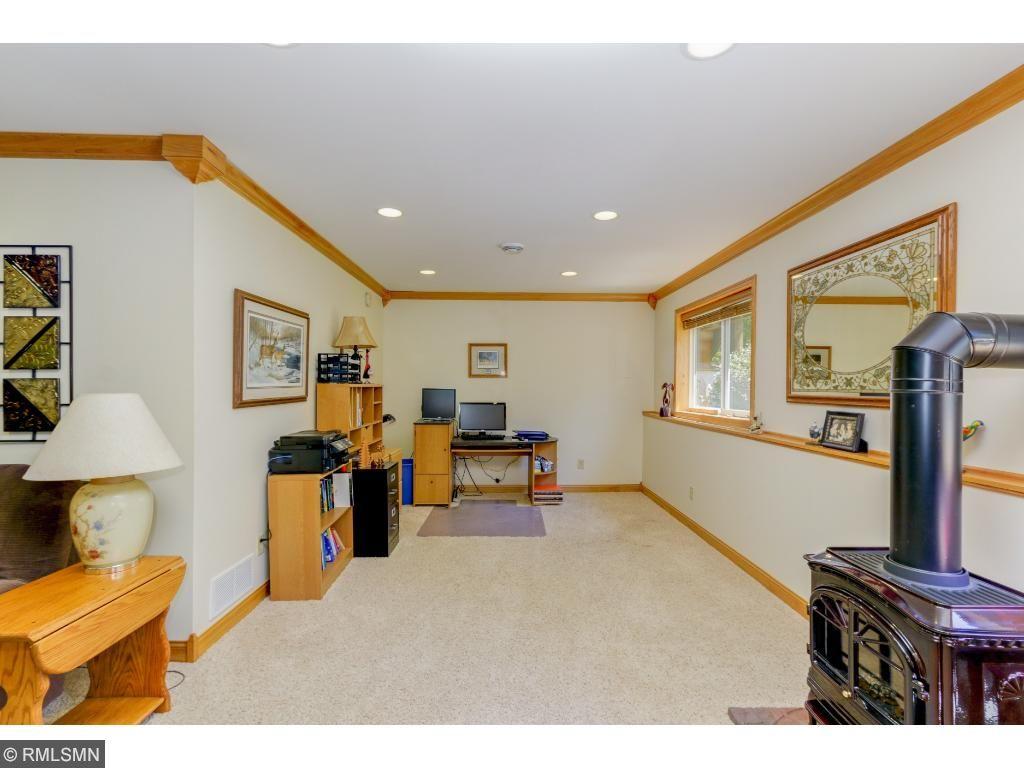 Large windows and recessed lighting illuminate the versatile lower level.