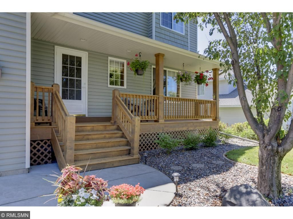 WELCOME to 2334 129th Lane NW -- Enjoy a glass of tea on your shady front porch!