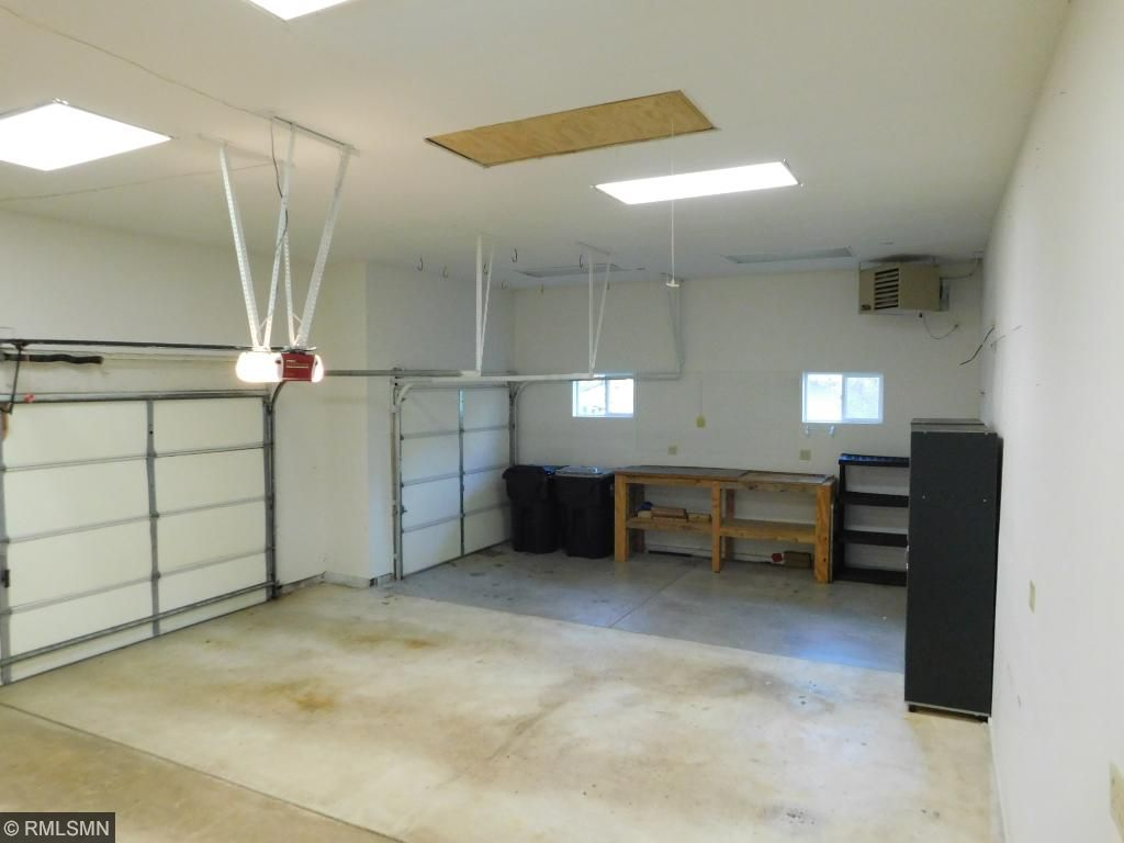 WOW! This garage has 3 stalls, is insulated and heated PLUS storage space access in ceiling waiting for you!