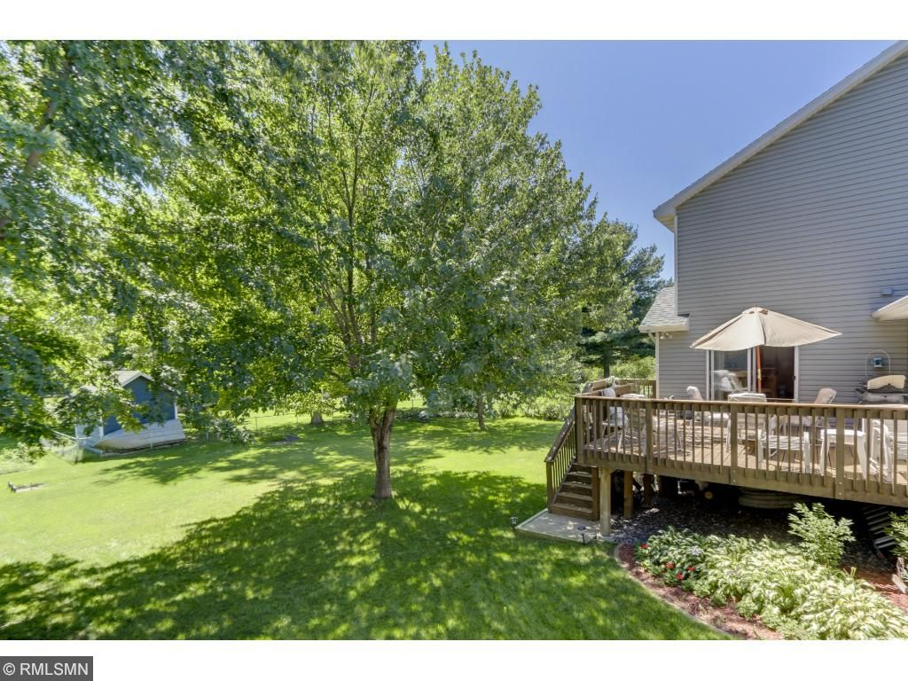 Perfection abounds! This well-maintained backyard benefits from mature trees.