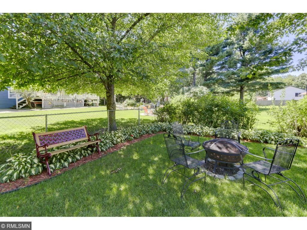 Family and guests will love sitting in the lush backyard warming up around a fire pit!
