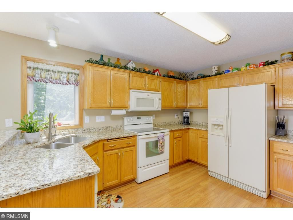 Granite counters sparkle in this spacious kitchen!