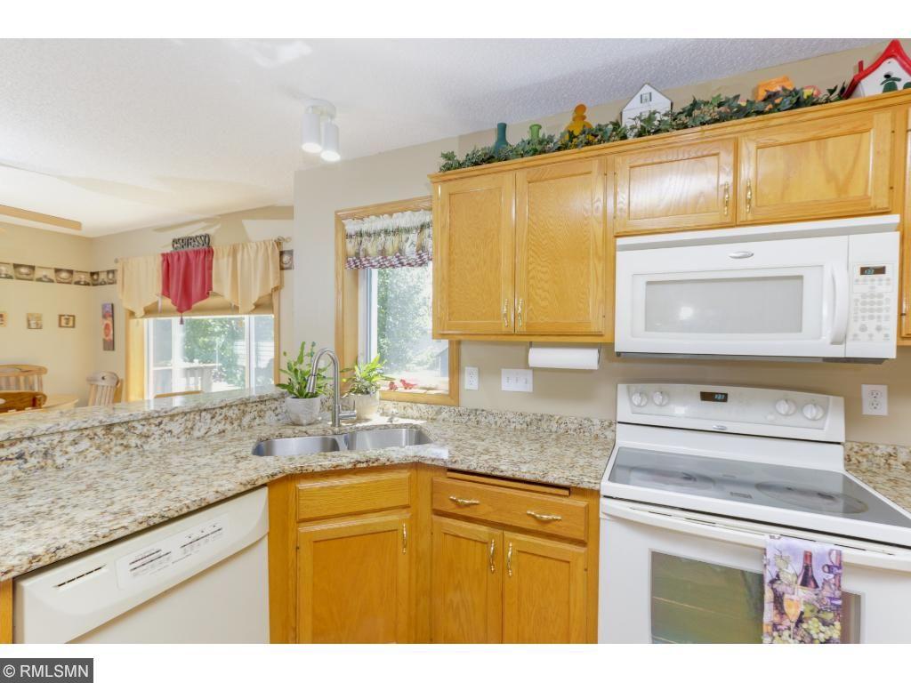 Brushed nickel fixtures beautifully modernize the kitchen.