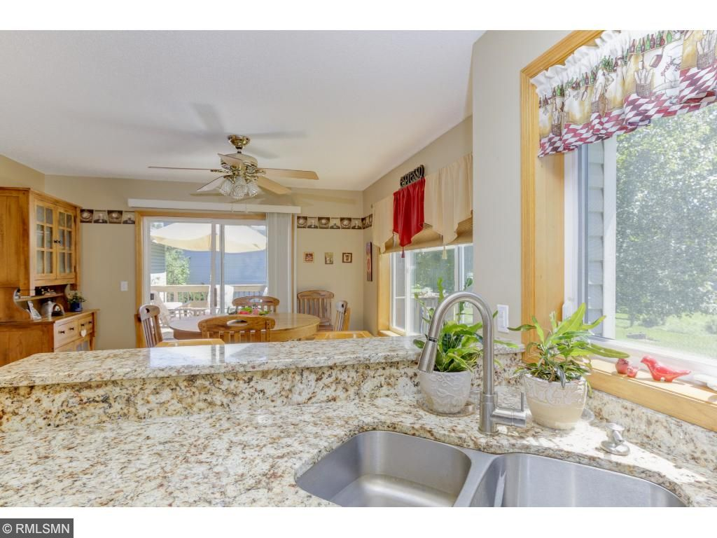 A window above the sink allows you to view the backyard, visit with those in dining area or on the large patio.