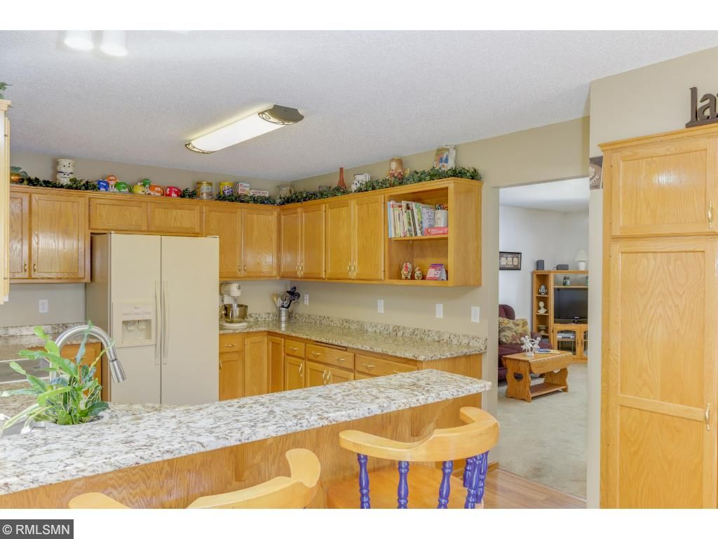 Adjacent to the kitchen pantry, the breakfast bar offers a casual dining location.