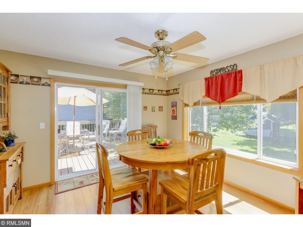 Surrounded by large windows, the bright dining area can easily expand out to the back deck!