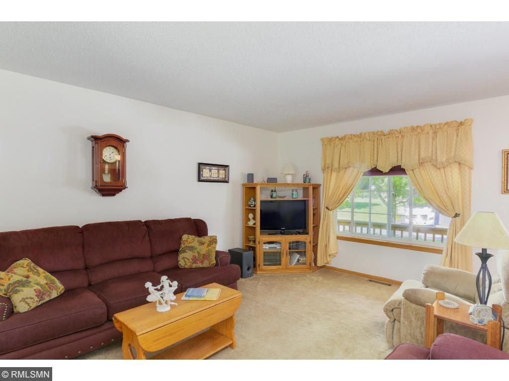 Wood trim surrounding the room imbues the space with a natural richness.