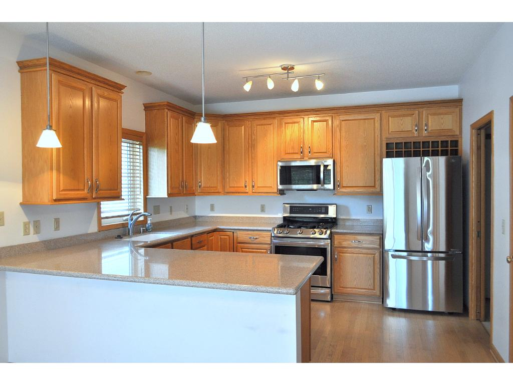 Open floor plan.  Kitchen opens in to the dining and living areas.  Hardwood floors