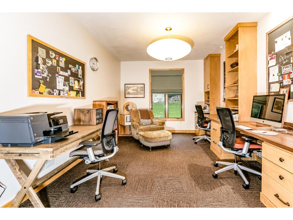 Main floor office has been redesigned to provide multiple work stations.