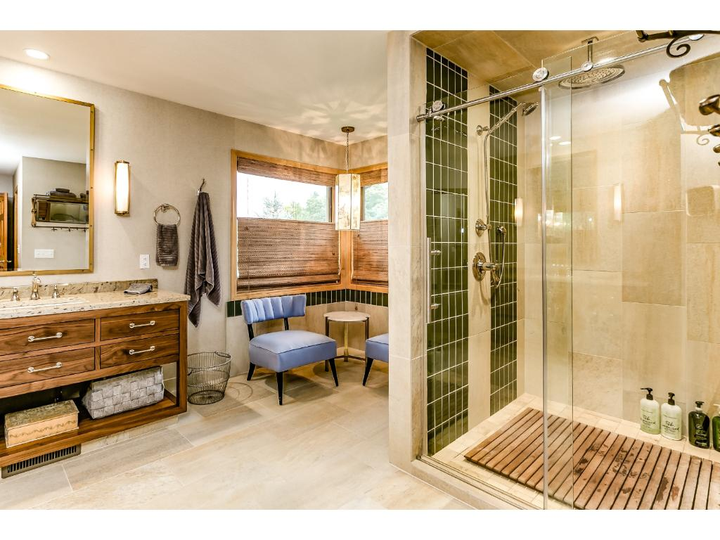 "The Master bath has been completely remodeled and features a large shower with a ""rain"" shower head. Bathroom is still plumbed and has space if someone wants to put in a tub."