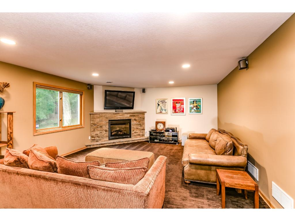 An additional family room with a gas fireplace in the lower level