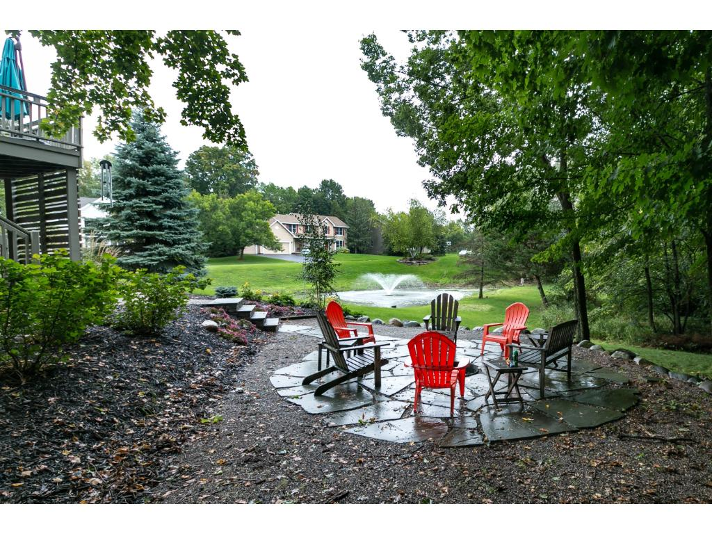 Enjoy this wonderful pond with fountain from either the upper level deck or lower level patio.