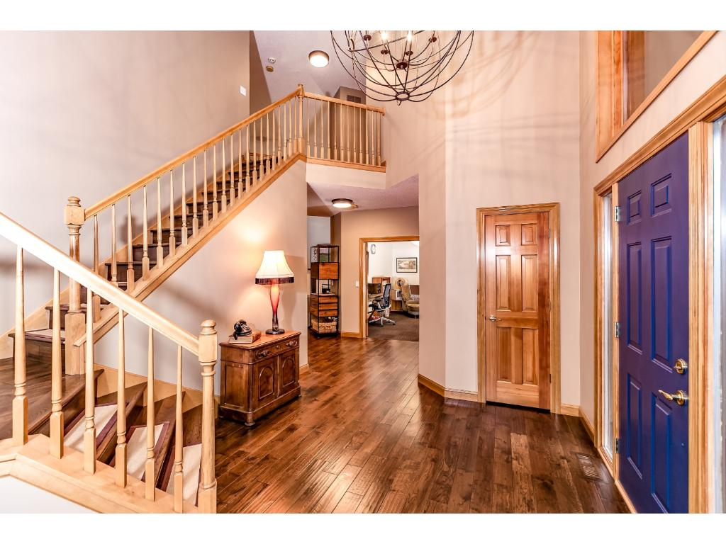 Gorgeous 2 story entryway. Notice the hand scraped oak floors.